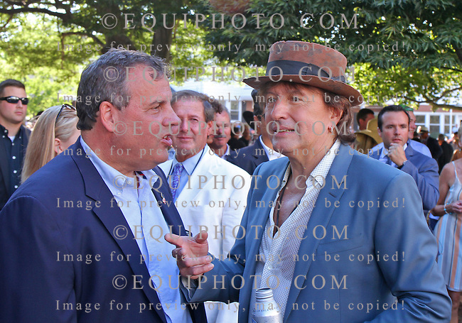 New Jersey Governor Chris Christie (L) talks with Bon Jovi guitarist Richie Sambora in the paddock at Monmouth Park in Oceanport, NJ on Sunday, August 2, 2015. Both were on hand to cheer on Triple Crown Champion American Pharoah in the $1,750,000 Haskell Stakes at Monmouth Park on August 2, 2015.