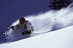 A man telemark skiing at Brighton, UT.