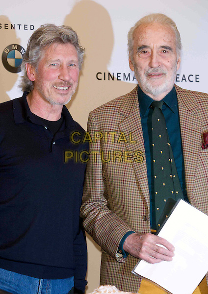 "ROGER WATERS & CHRISTOPHER LEE.Press conference & photo opportunity ahead of the ""Cinema for Peace"" gala held at the Hotel Adlon, alongside the 59th Berlinale Film Festival in Berlin, Germany..February 8th, 2009.half length black jacket blue beige green tie beard facial hair .CAP/PPG/JH.©Jens Hartmann/People Picture/Capital Pictures"