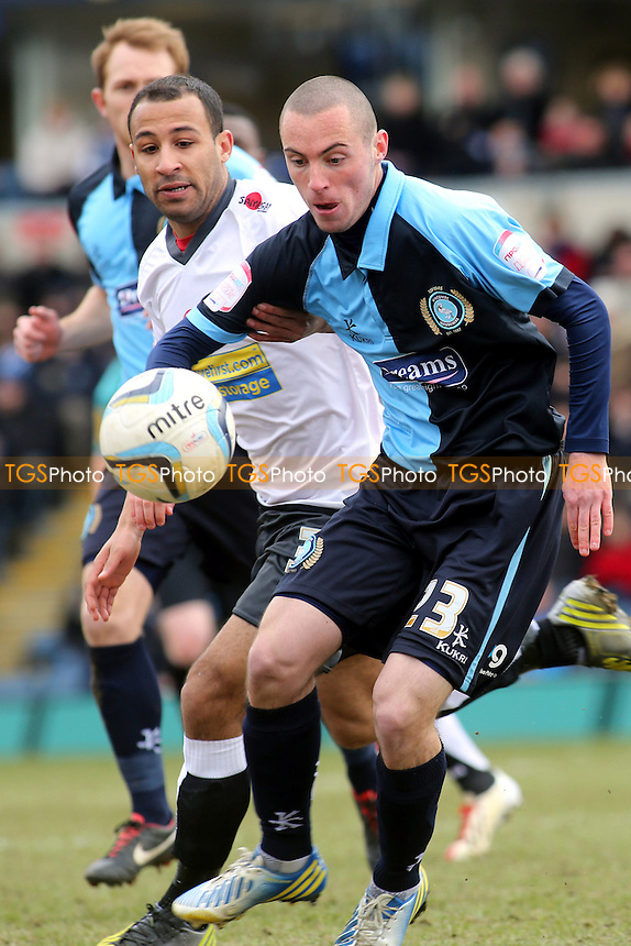 Wycombe's Michael Harriman shields the ball from Rommy Boco of Accrington - Wycombe Wanderers vs Accrington Stanley - NPower League Two Football at Adams Park, High Wycombe - 29/03/13 - MANDATORY CREDIT: Paul Dennis/TGSPHOTO - Self billing applies where appropriate - 0845 094 6026 - contact@tgsphoto.co.uk - NO UNPAID USE.