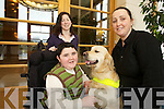 Christian Mayse who suffers from muscular dystrophy with his dog Adam  which he got from dogs for disabled to help Christian in everyday tasks also in photo are his mother Martina and Jenifer Dowler Dog Trainer on left.