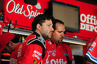 May 1, 2009; Richmond, VA, USA; NASCAR Sprint Cup Series driver Tony Stewart (left) with crew chief Darian Grubb during practice for the Russ Friedman 400 at the Richmond International Raceway. Mandatory Credit: Mark J. Rebilas-