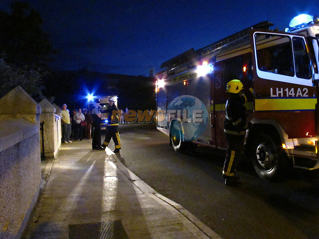 Drogheda Fire service attend the scene of a house fire in St Finians park late on Wednesday night, one occupand was removed from the scene by ambulance. A minor is believed to have escaped the house from an upstairs rear window, Garda sealed off the area last night..Picture Fran Caffrey/www.newsfile.ie