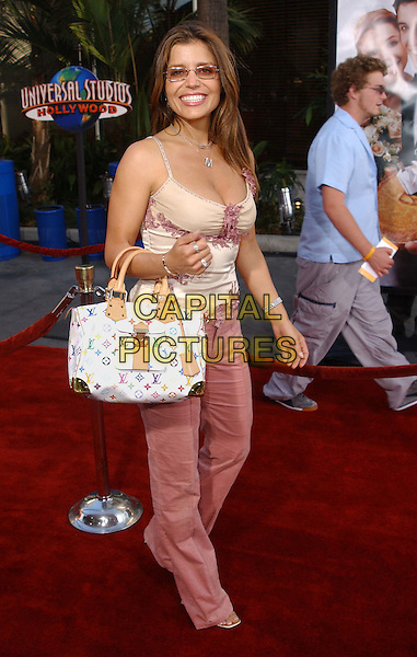 MINDY BURBANO.American Wedding LA Film Premiere held at Universal City Walk . July 24,2003.www.capitalpictures.com.sales@capitalpictures.com.©Capital Pictures.full length, full-length, yves sant laurent handbag