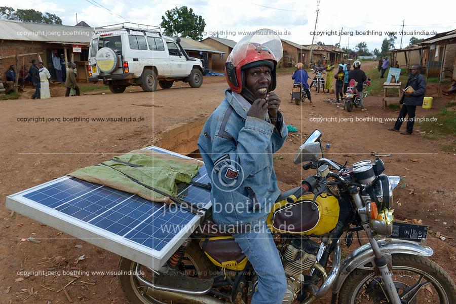 TANZANIA, Tarime, transport of PV solar panel by motorbike / Transport eines Solar Panels mit dem Motorrad