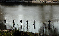 """North Korean go fishing in the North Korean country-side. North Korea is one of the last great dictatorships where, """"Our Dear Leader"""" Kim-Jong-il and his father Kim Il-sung """"The Great Leader"""" are worshipped and there is complete control of people who are constantly reminded of the evil deeds of the the west and USA."""