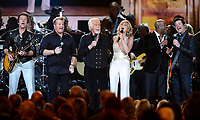 """20 March 2020 - Kenny Rogers, whose legendary music career spanned nearly six decades, has died at the age of 81. Rogers was inducted to the Country Music Hall of Fame in 2013."""" He had 24 No. 1 hits and through his career more than 50 million albums sold in the US alone. He was a six-time Country Music Awards winner and three-time Grammy Award winner. Some of his hits included """"Lady,"""" """"Lucille,"""" """"We've Got Tonight,"""" """"Islands In The Stream,"""" and """"Through the Years."""" His 1978 song """"The Gambler"""" inspired multiple TV movies, with Rogers as the main character. File Photo: 06 November 2013 - Nashville, Tennessee - Rascal Flatts, Kenny Rogers, Jennifer Nettles, Darius Rucker. 47th CMA Awards, Country Music's Biggest Night, held at Bridgestone Arena. Photo Credit: Laura Farr/AdMedia"""