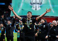 1st March 2020; Wembley Stadium, London, England; Carabao Cup Final, League Cup, Aston Villa versus Manchester City; Rodrigo of Manchester City celebrates towards the Manchester City fans while wearing a winners medal