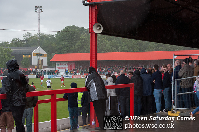 Ebbsfleet 0 Dover Athletic 1, 23/08.2014. Stonebridge Road, Conference South play-off final. The Skrill South play-off final between Ebbsfleet and Dover Athletic from Stonebridge Road. Ebbsfleet fans take shelter from the rain. Dover won the match 1-0 to secure promotion to the Conference Premier.  Photo by Simon Gill.