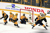 June 5th 2017, Nashiville, TN, USA;  Nashville Predators goalie Pekka Rinne (35) makes a pad save on Pittsburgh Penguins center Jake Guentzel (59) during Game 4 of the Stanley Cup Final between the Nashville Predators and the Pittsburgh Penguins, held on June 5, 2017, at Bridgestone Arena in Nashville, Tennessee.