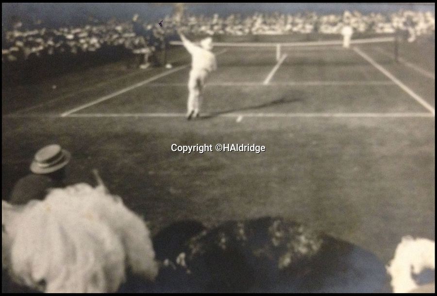 BNPS.co.uk (01202) 558833<br /> Picture: HAldridge/BNPS<br /> <br /> ****Plese use full byline****<br /> <br /> Some of the earliest photographs taken of the Wimbledon tennis championships have emerged after 104 years.<br /> <br /> The black and white snaps were taken by a spectator at the 1910 tournament and many show the prolific champion of the day, Tony Wilding.<br /> <br /> The images include shots of a primitive-looking Centre Court as well as some of the outside courts that are separated by waist-high netting.<br /> <br /> Wimbledon is renowned for its tradition and formality but the conservative outfits worn by male and female players and fans are in stark contrast to today's fashion.