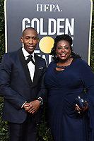 Nominated for BEST ORIGINAL SONG &ndash; MOTION PICTURE for his work on &quot;Mighty River&quot; for &ldquo;Mudboundd&rdquo;,  Raphael Saadiq and guest arrive at the 75th Annual Golden Globe Awards at the Beverly Hilton in Beverly Hills, CA on Sunday, January 7, 2018.<br /> *Editorial Use Only*<br /> CAP/PLF/HFPA<br /> &copy;HFPA/Capital Pictures