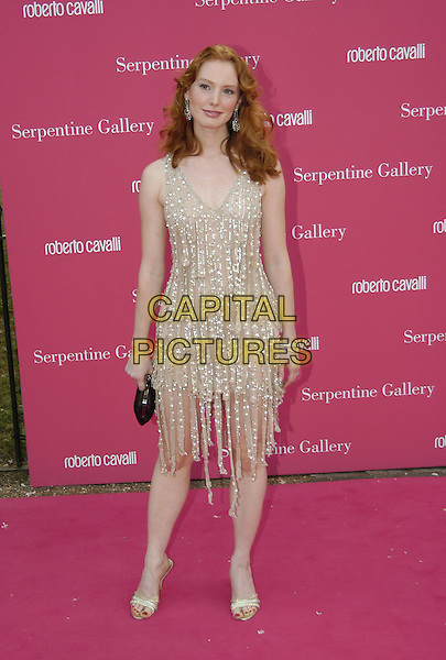 ALICIA WHITT.Arrives at the Serpentine Gallery Summer Party,.Kensington Palace Gardens,.London, 16 June 2004..full length full-length smiling witt silver dangly earings beaded jewelled dress black purse.www.capitalpictures.com.sales@capitalpictures.com.©Capital Pictures