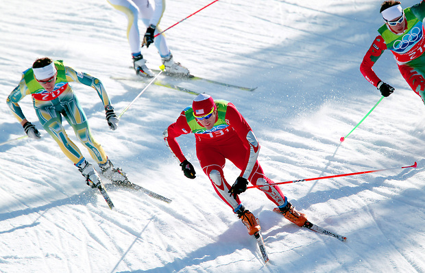USA's Torin Koos leads a group of skiers down a slope in the men's  team sprint freestyle semifinal at the XXI Olympic Winter Games Monday, February 22, 2010 at Whistler Olympic Park in Whistler, British Columbia.