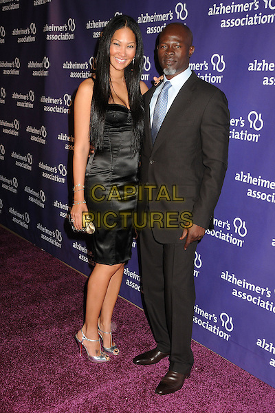 "KIMORA LEE & DJIMON HOUNSOU.19th Annual ""A Night at Sardi's"" Benefiting the Alzheimer's Association held at the Beverly Hilton Hotel, Beverly Hills, California, USA, 16th March 2011..full length black dress silver shoes sandals suit blue tie couple grey gray clutch bag bustier tattoo on foot christian louboutin .CAP/ADM/BP.©Byron Purvis/AdMedia/Capital Pictures."