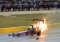 Sept. 22, 2012; Ennis, TX, USA: NHRA top fuel dragster driver Scott Palmer has an engine explosion with a fire during qualifying for the Fall Nationals at the Texas Motorplex. Mandatory Credit: Mark J. Rebilas-