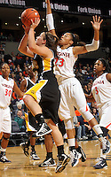 Dec. 18, 2010; Charlottesville, VA, USA; UMBC Retrievers guard Michelle Kurowski (20) shoots the ball in front of Virginia Cavaliers guard Ataira Franklin (23) during the game at the John Paul Jones Arena.  Mandatory Credit: Andrew Shurtleff