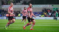 Lincoln City's Neal Eardley, right, celebrates scoring his side's equalising goal to make the score 1-1 with team-mate Danny Rowe<br /> <br /> Photographer Chris Vaughan/CameraSport<br /> <br /> The EFL Sky Bet League Two - Lincoln City v Macclesfield Town - Saturday 30th March 2019 - Sincil Bank - Lincoln<br /> <br /> World Copyright © 2019 CameraSport. All rights reserved. 43 Linden Ave. Countesthorpe. Leicester. England. LE8 5PG - Tel: +44 (0) 116 277 4147 - admin@camerasport.com - www.camerasport.com