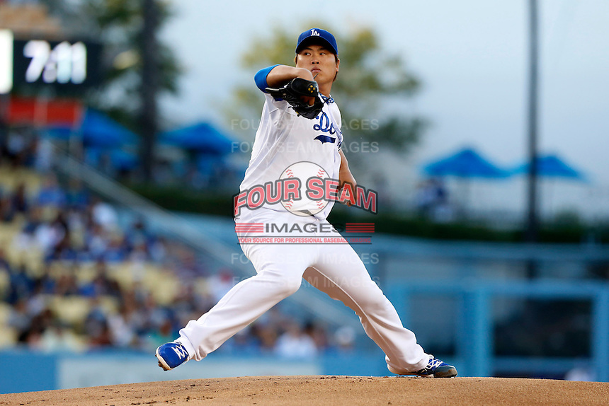 Hyun-Jin Ryu #99 of the Los Angeles Dodgers pitches against the San Francisco Giants at Dodger Stadium on June 25, 2013 in Los Angeles, California. (Larry Goren/Four Seam Images)