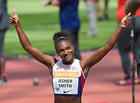 Dina ASHER-SMITH of GBR celebrates breaking the British 100m record in a time of 10.99 during the Sainsburys Anniversary Games at the Olympic Park, London, England on 25 July 2015. Photo by Andy Rowland.