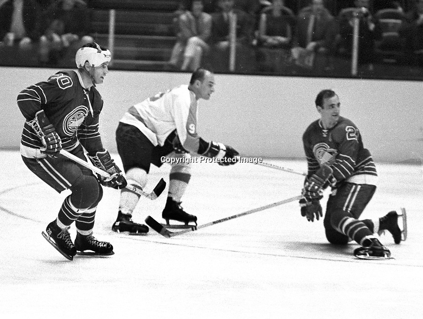Seals vs Flyers hockey 1967, Seals Charlie Burns and Bob Baun, Flyer Leon Rochefort..photo/Ron Riesterer
