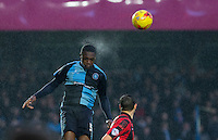 Anthony Stewart of Wycombe Wanderers wins the ball in the rain during the Sky Bet League 2 match between Wycombe Wanderers and Morecambe at Adams Park, High Wycombe, England on 2 January 2016. Photo by Andy Rowland / PRiME Media Images