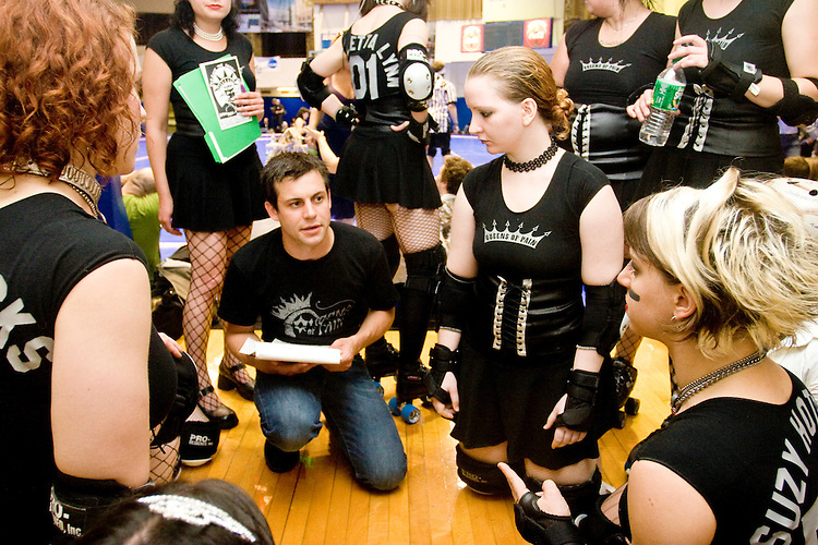 Bust'er Cheatin, manager of the Queens of Pain, with some last minute instructions to the team before they clash with the Brooklyn Bombshells at a Gotham Girls Roller Derby bout in New York City on June 2, 2006.
