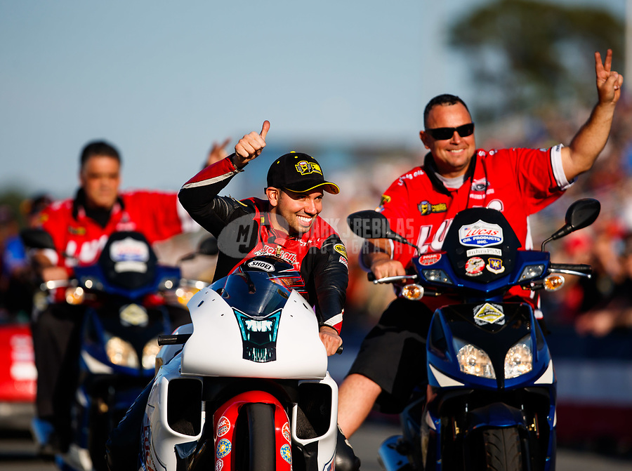 Mar 16, 2018; Gainesville, FL, USA; NHRA pro stock motorcycle rider Hector Arana Jr (center) and crew celebrate after becoming the first motorcycle to break the 200 mph speed barrier during qualifying for the Gatornationals at Gainesville Raceway. Mandatory Credit: Mark J. Rebilas-USA TODAY Sports