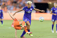 Lianne Sanderson (10) of the Orlando Pride knocks Andressa (17) of the Houston Dash off her feet while going for the ball on Friday, May 20, 2016 at BBVA Compass Stadium in Houston Texas. The Orlando Pride defeated the Houston Dash 1-0.