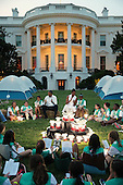 United States President Barack Obama and first lady Michelle Obama sit around a pile of battery-operated lanterns while hosting a group of Girl Scouts from across the country for a campout on the South Lawn of the White House June 30, 2015 in Washington, DC.  The first family hosted the event as part of the first lady's Let's Move! Outside initiative and for Girl Scouts to earn the new Girls' Choice Outdoor badge.<br /> Credit: Chip Somodevilla / Pool via CNP