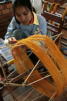 Artisans d'Angkor Silk Farm - Spinning Silk - After the civil war in Cambodia, many Cambodian arts were in danger of dying out until a professional training school was founded to help young Cambodians rediscover their arts and crafts and give them the opportunity to take part in the rebuilding of their country. Artisans d'Angkor was established as a working school for the young craftsmen that were trained - here the skilled artisans have been organized into a self-sustaining craft network and workforce.