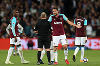 Andy Carroll of West Ham United and referee Jon Moss during West Ham United vs Manchester United, Premier League Football at The London Stadium on 10th May 2018