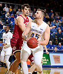 BROOKINGS, SD - JANUARY 13: Ian Theisen #45 from South Dakota State University eyes the basket against Daniel Amigo #44 from Denver during their game Saturday afternoon at Frost Arena in Brookings, SD.  (Photo by Dave Eggen/Inertia)