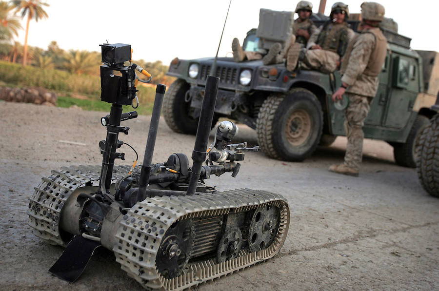 A Marine explosive ordinance disposal team attached to 3rd Battalion 1st Marines (3/1) utilizes a remote-controlled robot and high explosives to investigate, dislodge, and destroy IEDs discovered by sweeping infantry foot patrols during  Operation River Gate - the search for insurgents and weapons in the Al-Anbar Province cities of Haditha, Haqlaniya, and Barwanah on Monday, Oct. 10 2005. Such sweeps have discovered dozens of IEDs since the operation commenced a week ago.