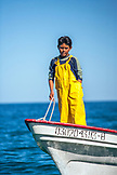 MEXICO, Baja, Magdalena Bay, Pacific Ocean, a young boy on one of the grey whale watching tour boats