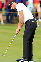 Dustin Johnson (USA) takes his putt on the 14th green during Thursday's Round 1 of the 145th Open Championship held at Royal Troon Golf Club, Troon, Ayreshire, Scotland. 14th July 2016.<br /> Picture: Eoin Clarke | Golffile<br /> <br /> <br /> All photos usage must carry mandatory copyright credit (&copy; Golffile | Eoin Clarke)
