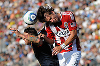Alan Gordon (16) of CD Chivas USA and Danny Califf (4) of the Philadelphia Union go up for a header during a Major League Soccer (MLS) match at PPL Park in Chester, PA, on September 25, 2010.