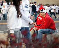 Jason Griggs of Lancaster, Oh (right) is conflicted as he sports his Ohio State sweatshirt and his Penn State cap (where he graduated from) while sitting with his friend Brad Bennett of Columbus (who graduated from Ohio State and works there now) before Saturday's NCAA Division I football game at Beaver Stadium in University Park, PA on October 25, 2014. (Columbus Dispatch photo by Jonathan Quilter)
