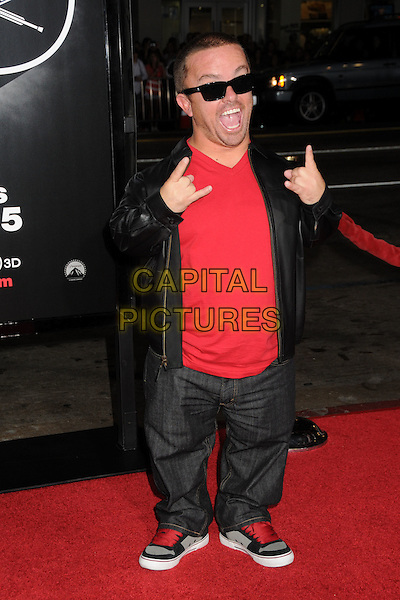 "JASON ACUNA aka ""Wee Man"".""Jackass 3D"" Los Angeles Premiere held at Grauman's Chinese Theatre, Hollywood, California, USA, .13th October 2010..full length red t-shirt sunglasses leather black jacket trainers laces  hands gesture .CAP/ADM/BP.©Byron Purvis/AdMedia/Capital Pictures."