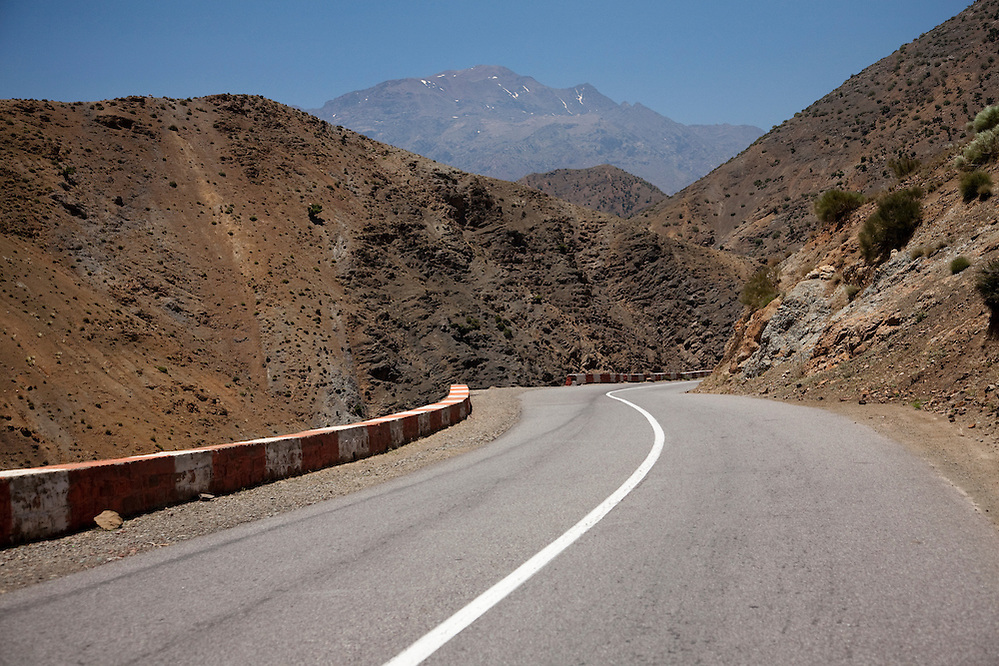 The P31 highway heads south-east of Marrakech, Morocco into the dramatic High Atlas mountains.