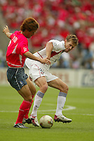 Brian McBride tries to secure the ball. The USA tied South Korea, 1-1, during the FIFA World Cup 2002 in Daegu, Korea.