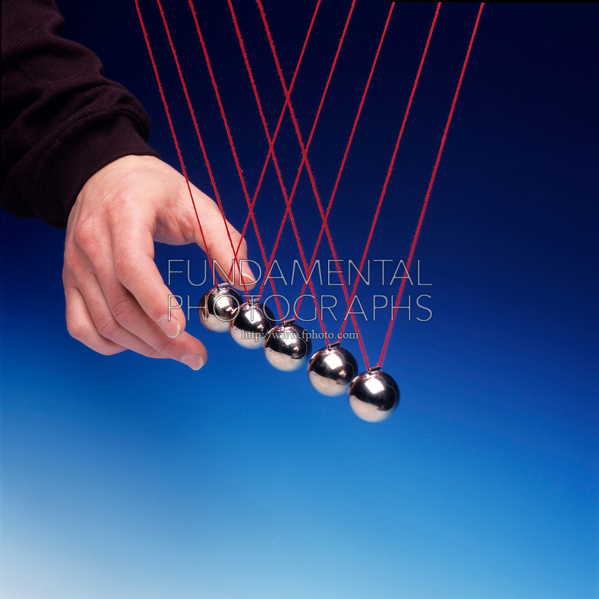 NEWTON TOY PENDULA: COLLISION EXPERIMENT<br /> Newton's Third Law Conservation of Momentum<br /> Two pendula bobs used as a projectile collides with three other pendula bobs displacing two pendula bobs equal to the original displacement of the projectile bob.