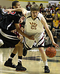 Central Catholic's Andy Clark is fouled by Lincoln's J.T. Flowers in the semifinals of the 6A boys state championship at McArthur Court Friday March 13, 2009.