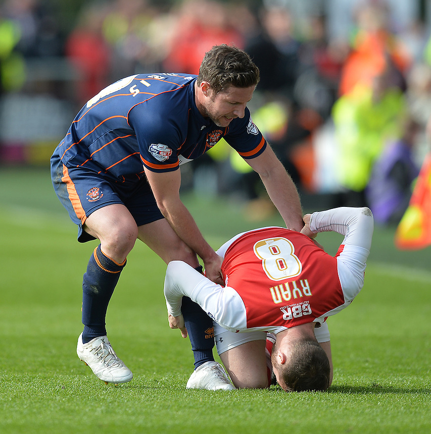 Blackpool's David Norris tries to get Fleetwood Town's Jimmy Ryan to his feet after fouling him<br /> <br /> Photographer Dave Howarth/CameraSport<br /> <br /> Football - The Football League Sky Bet League One - Fleetwood Town v Blackpool - Saturday 23rd April 2016 - Highbury Stadium - Fleetwood  <br /> <br /> &copy; CameraSport - 43 Linden Ave. Countesthorpe. Leicester. England. LE8 5PG - Tel: +44 (0) 116 277 4147 - admin@camerasport.com - www.camerasport.com