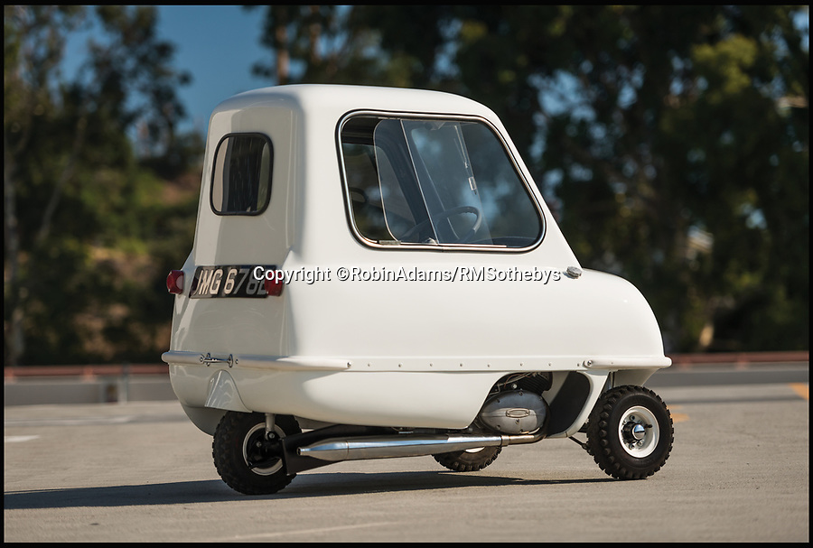 BNPS.co.uk (01202 558833)<br /> Pic: RobinAdams/RMSothebys/BNPS<br /> <br /> The smallest production car ever made has emerged for a rather large sum of &pound;90,000 - 450 times what it first sold for. <br /> <br /> The dinky Peel P50 microcar is about the same size as the average mobility scooter - measuring only 4ft 5ins long and 3ft 3ins wide and tall. <br /> <br /> Isle of Man-based manufacturer Peel Engineering Company only sold 50 P50s for &pound;199 each between 1962 and 1965. <br /> <br /> The Peel will be sold in Monterey, California, on August 18.