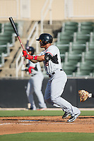 Marcus Greene Jr. (6) of the Hickory Crawdads follows through on his swing against the Kannapolis Intimidators at CMC-Northeast Stadium on May 21, 2015 in Kannapolis, North Carolina.  The Intimidators defeated the Crawdads 2-0 in game one of a double-header.  (Brian Westerholt/Four Seam Images)