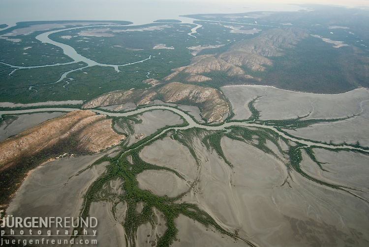 Mud flats of Derby. The town of Derby is located on the tidal mud flats on the edge of the King Sound. It has the highest tidal range of any port in Australia with 11.5 metres..Derby, Western Australia