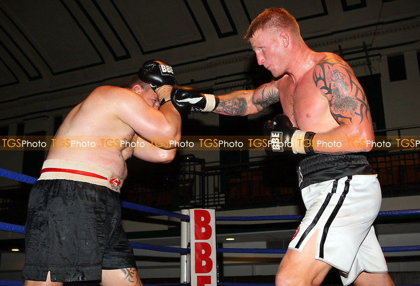 Tom Dallas (Chatham, white shorts) defeats Vlado Szabo (black shorts) in a Heavyweight contest at York Hall, Bethnal Green, promoted by Maloney Promotions - 13/09/08 - MANDATORY CREDIT: Gavin Ellis/TGSPHOTO - Self billing applies where appropriate - 0845 094 6026 - contact@tgsphoto.co.uk - NO UNPAID USE.