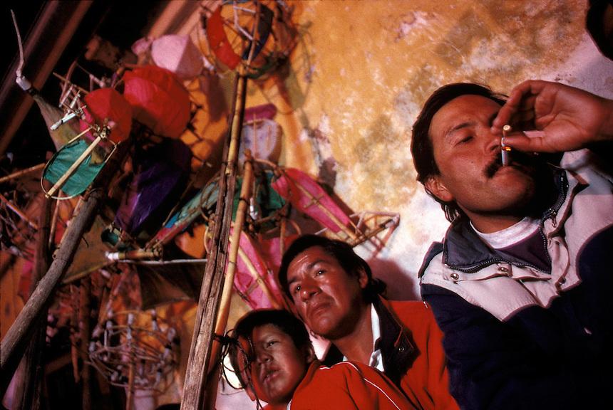 Cusqueños celebrate the Feast of the Pentacost in a cafe in Cuzco, Peru.