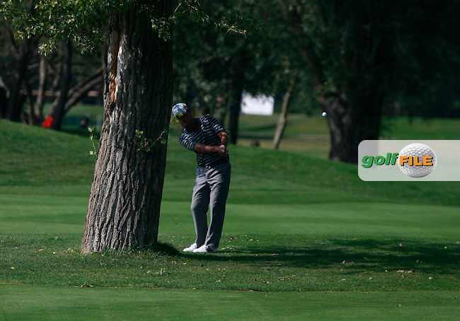 Raymond Russell (SCO) playing his 2nd shot from behind a tree on the 13th hole during Saturday's Round 3 of the Austrian Open presented by Lyoness at the Diamond Country Club, Atzenbrugg, Austria, 24th September 2011 (Photo Eoin Clarke/www.golffile.ie)